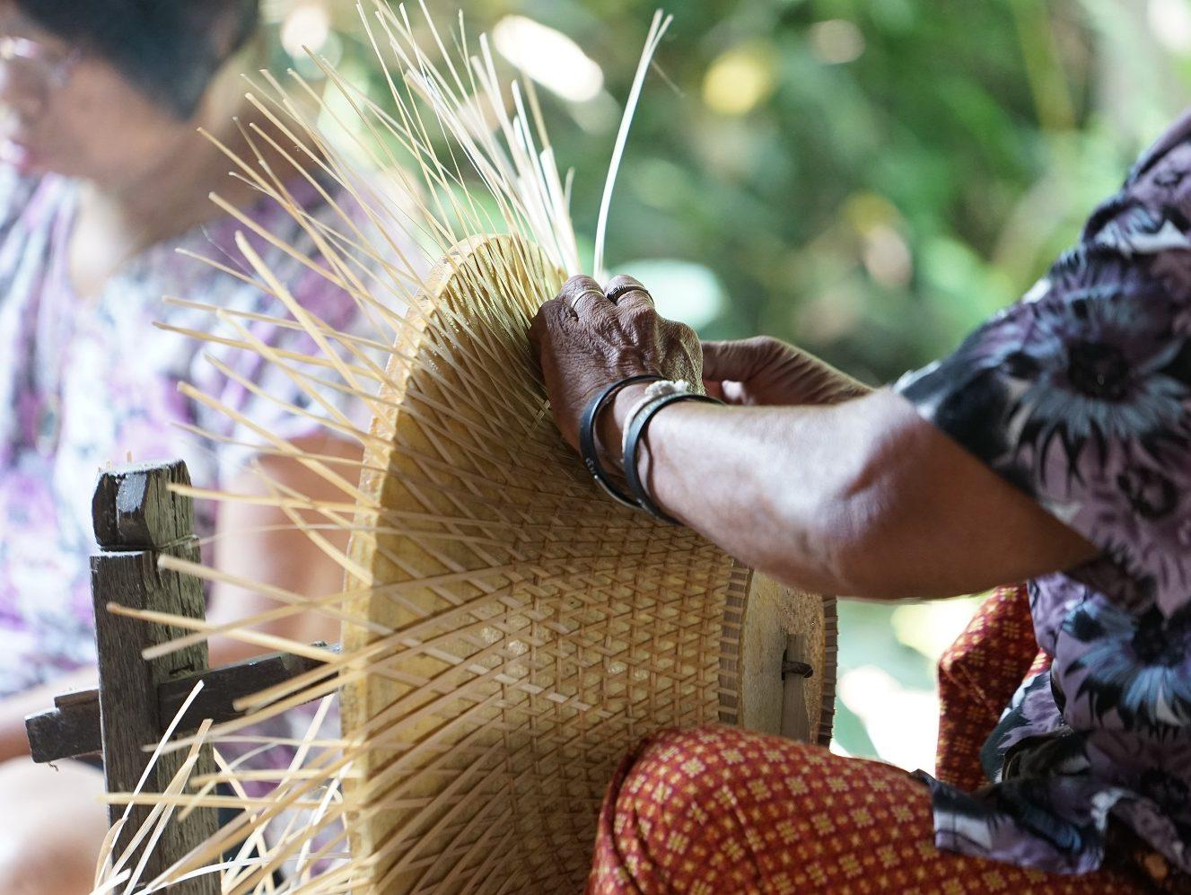 handcrafting straw hats